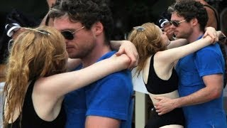 Game of Thrones star Richard Madden passionately snogs actress Ellie Bamber on holiday