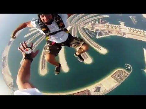 في دبي ..لن تصدق جمال القفز المظلي .. اكثر من رائع كانك ...