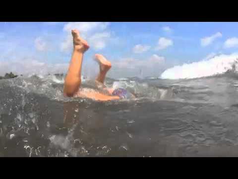 Hot girl on beach does epic handstand
