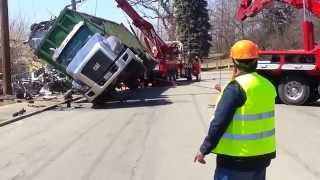 Truck Tips Over and Gets Pulled Upright With 2 Large Tow Trucks
