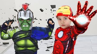 Yusuf pretend play with Superhero