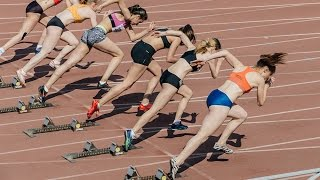 Women athletes start and run at sprint competitions at stadium
