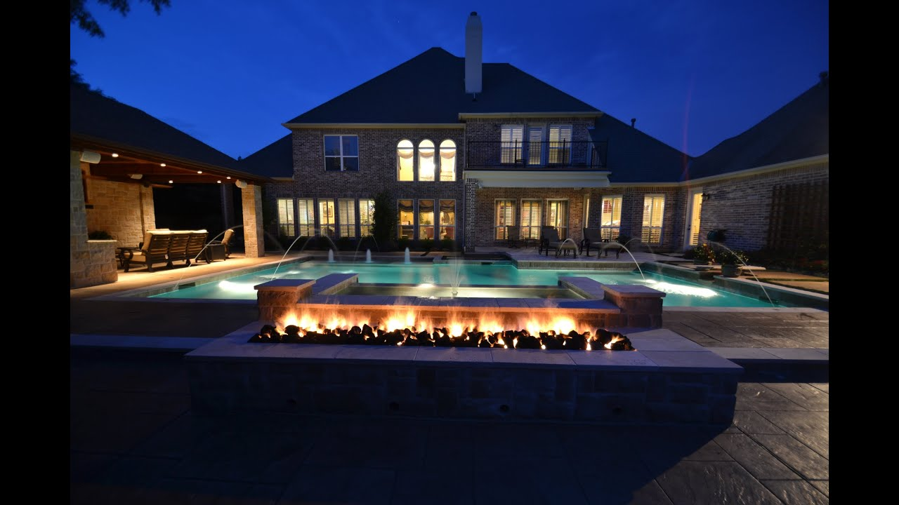 Relaxing DFW Pools With Fire Water Features