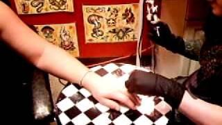 Monica's wedding ring tattoo at Kadillac Tattoo