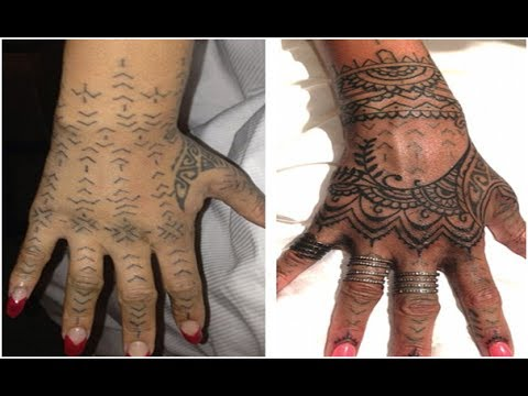 Rihanna Gets More Work Done On Her Tribal Tattoo