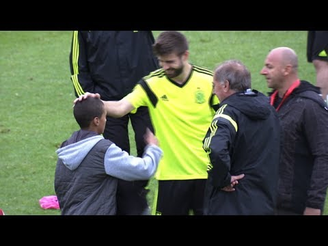 World Cup 2014 - Gerard Pique Gives His Tracksuit Top To Young Pitch Invader thumbnail