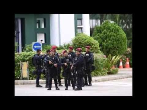 Singapore police shoot dead man near Shangri La summit