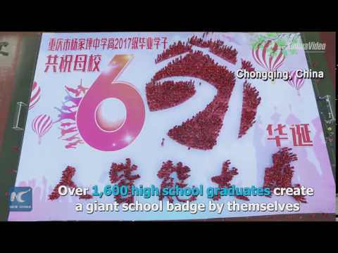 Students stand in formation of school badge to celebrate graduation in Chongqing