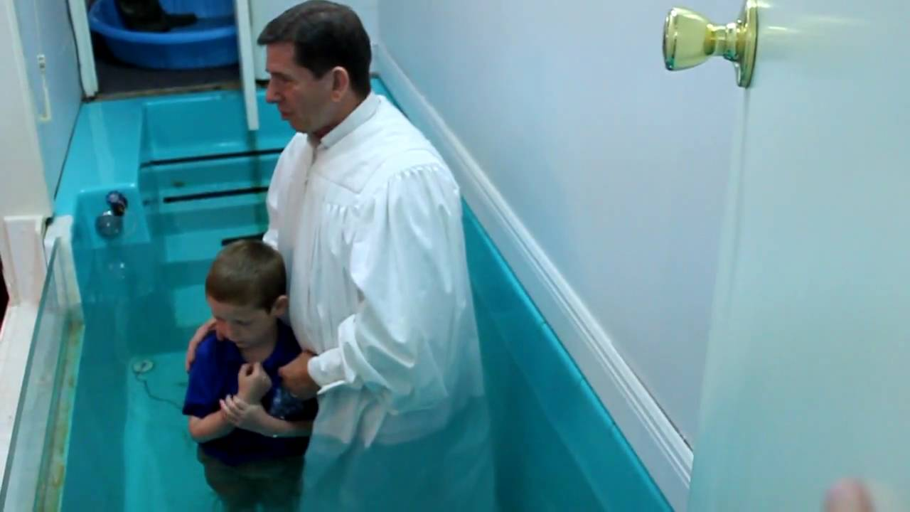 christian getting baptized at