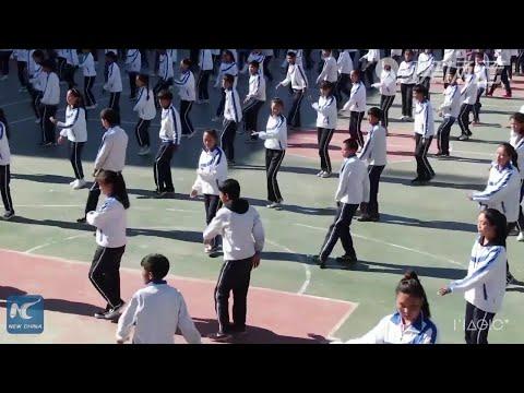 Students practice string dance during break at school in China's Tibet