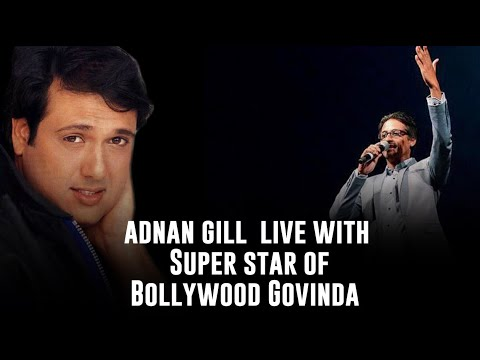 Adnan Gill singing in front of Govinda