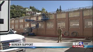 Military installing razor wire on wall at DeConcini Port of Entry