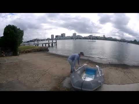 Removing barnacles from our pvc sailboat tender