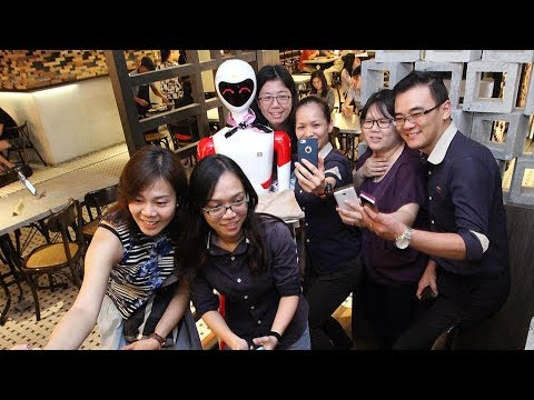 Ipoh kopitiam draws customers with robot waitresses