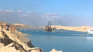شاهد الملاحة بالقناة الجديدة والتكريك وفندق العاملين بالكراكات وجبال الرمال من الحفر