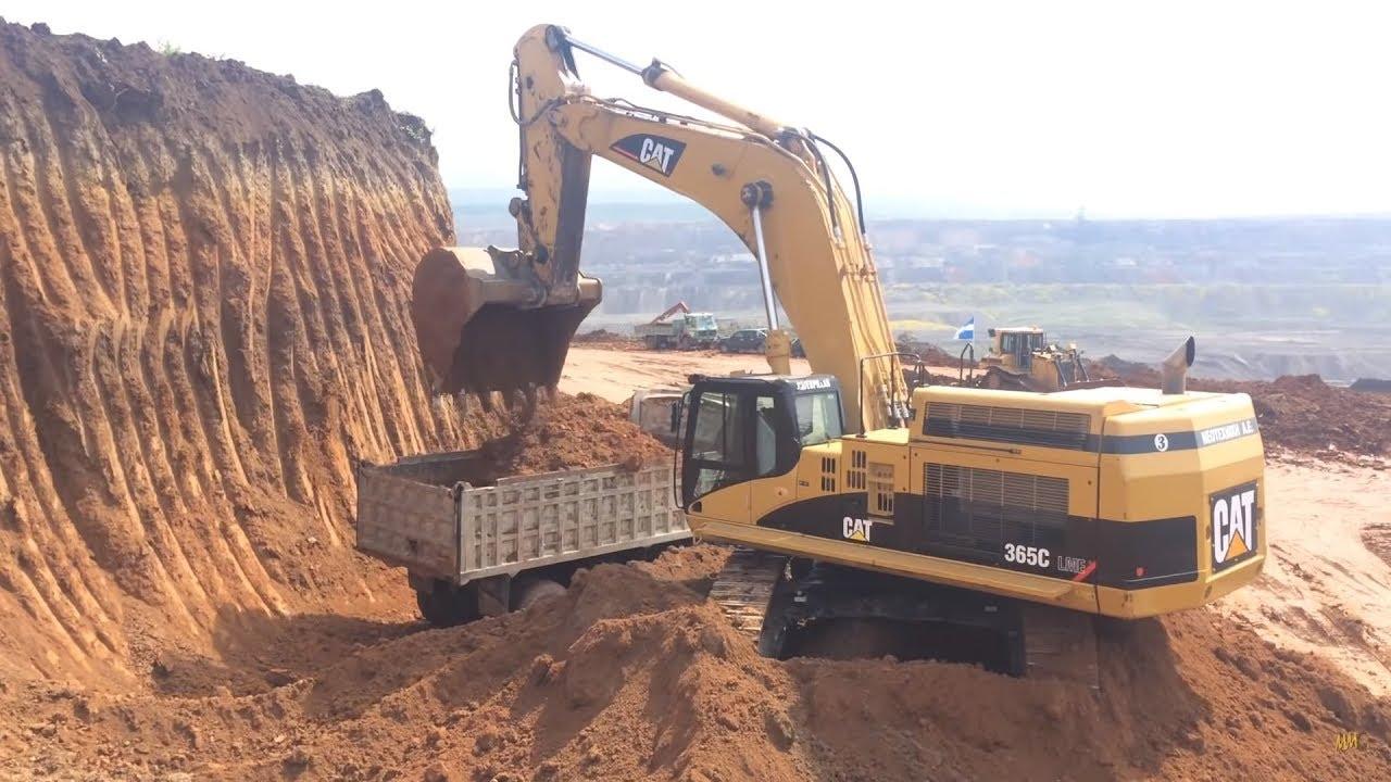 Cat 365C Excavator Loading Trucks
