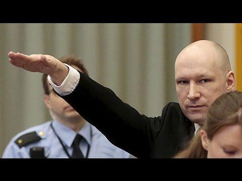 Mass killer Anders Breivik makes Nazi salute in court