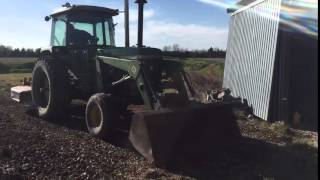 John Deere 4430 with a 148 loader smoothing gravel driveway