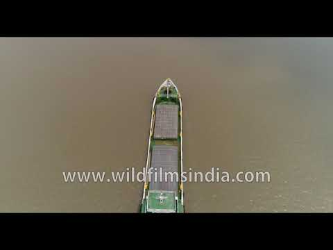 A loaded cargo vessel moves towards Bangladesh via Datta river in Sundarbans