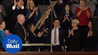 Trump honors North Korean defector during his SOTU address - Daily Mail