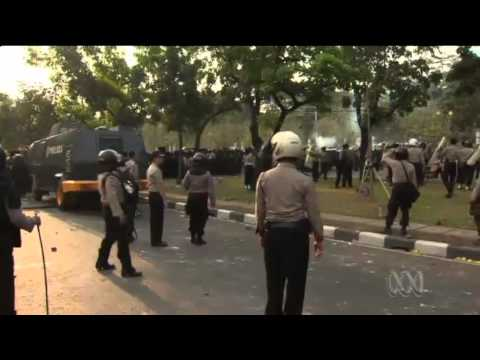 Police and protesters clash in Jakarta