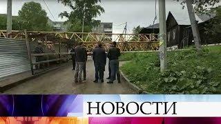В Перми выясняют причины падения башенного крана на жилые дома.