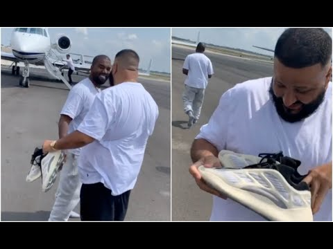 kanye-west-gives-dj-khaled-unreleased-yeezy's-off-his-feet-at-airport