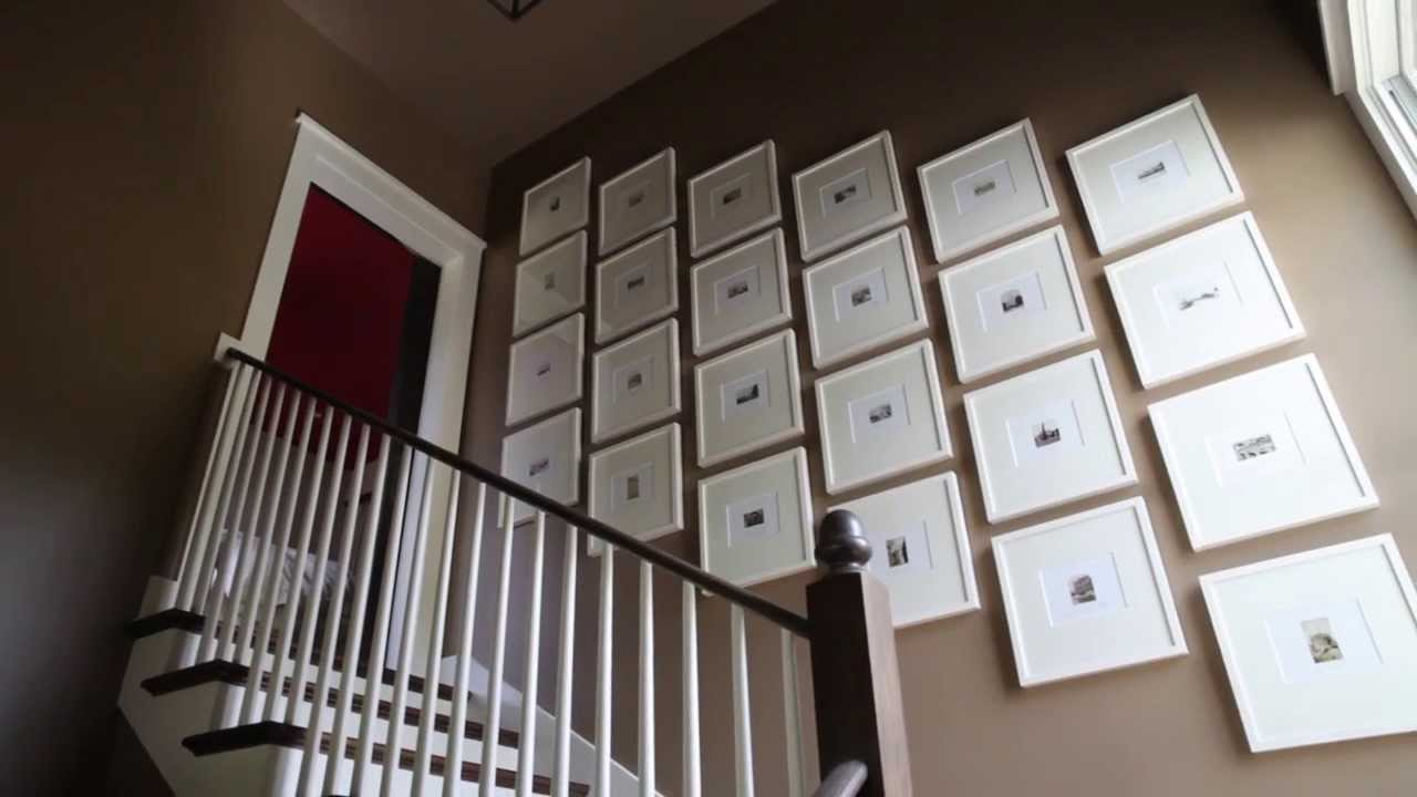 How To Hang Art In A Stairway Southern Living