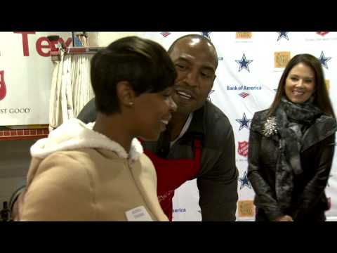 Charlotte Jones Anderson, Darren Woodson and DCC distribute gifts for the Salvation Army