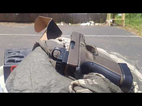 Glock 19 and the Redfield Accelerator.