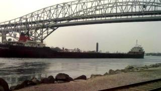 FREIGHTER blowing its horn arriveing from lake huron near the bluewater bridge 2010