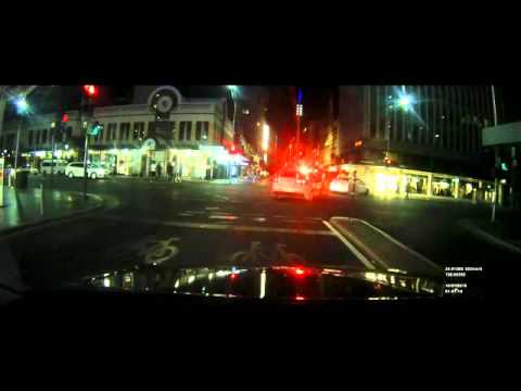 car runs red light in front of police adelaide cbd