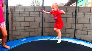 Andrei play with an inflatable trampoline