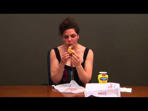Livia Scott eats a hamburger
