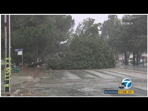 Scenes from Southern Californias storm: Rain, mudflows, flooded streets
