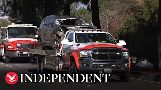 Tiger Woods' wrecked SUV towed after car crash