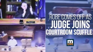 Robe comes off as judge joins courtroom scuffle thumbnail