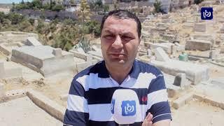 بلدية الكرك ومتطوعون ينفذون حملة لتنظيف المقابر  (10/8/2019)