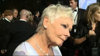 """Skyfall Premiere: Dame Judi Dench calls Daniel Craig a """"very naughty boy"""""""
