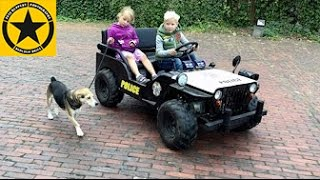 Gasoline JEEP for CHILDREN Walking the POLICE Dog