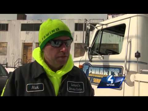 Two outside workers, two very different outlooks on working in cold weather