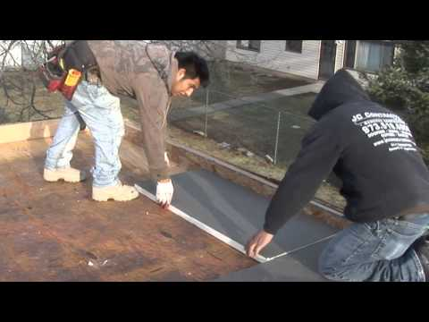 JC Contracting Installs A Tapered Solutions 1/8-Inch Slope Paneled Flat Commercial Roofing System
