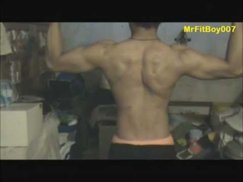 Natural Fit Boy Showing and Flexing Muscles: Back, Arms and Chest