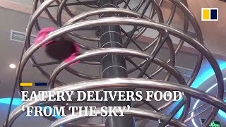 Restaurant uses spiral slides to deliver food to diners in China