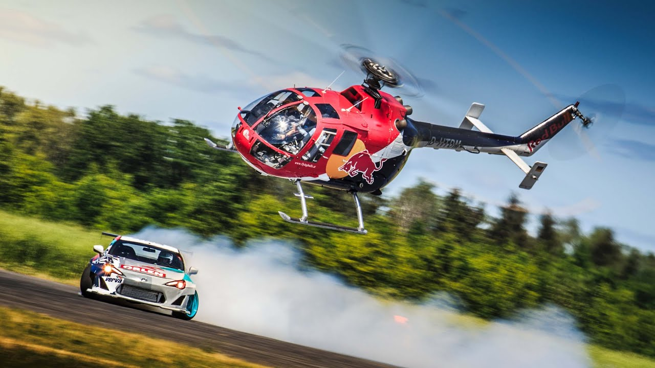 aerobatic helicopter chases drifting race car youtube