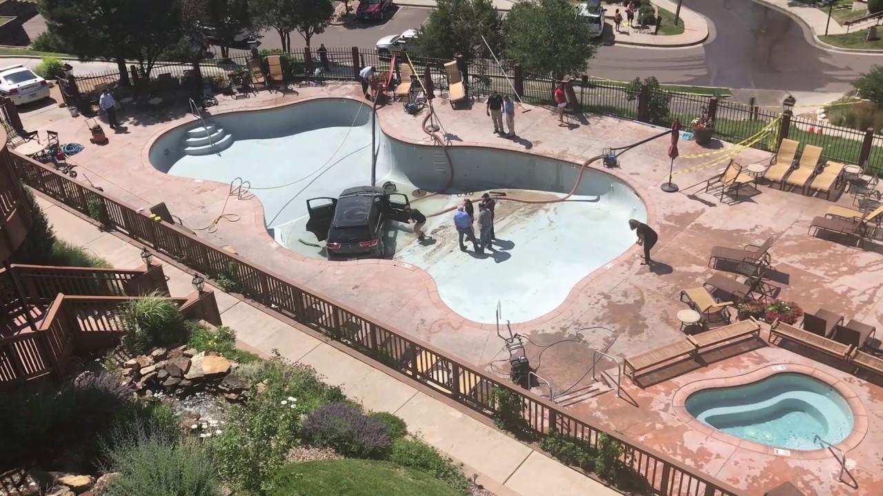 BTL: Car flies into a Colorado Springs resort pool - YouTube