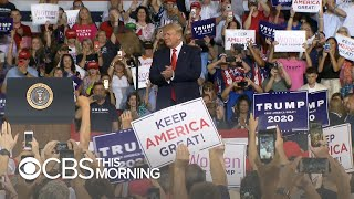 "Trump rally highlights ""most visible dividing line"" in American politics"