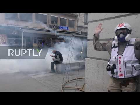 france:-riot-police-fire-tear-gas-at-pension-reform-march-in-lyon
