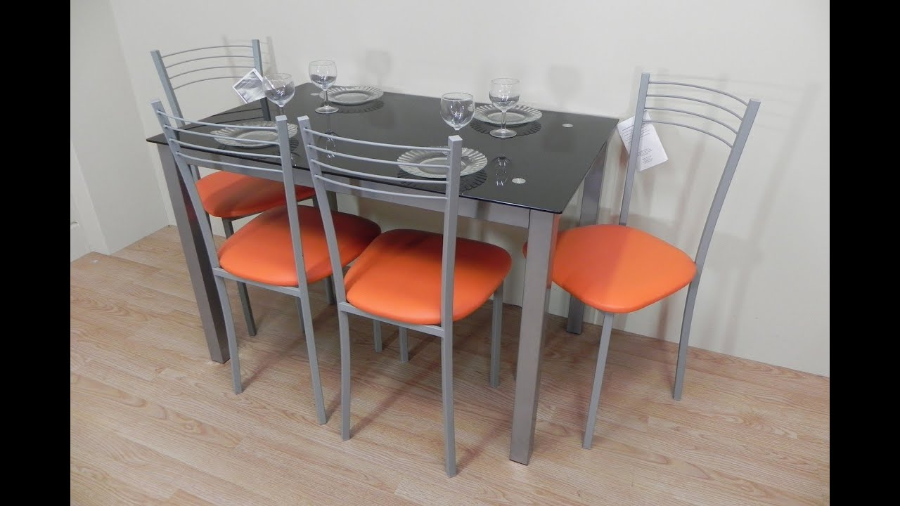 Pack mesa de cristal negro y 4 sillas de metal polipiel for Sillas comedor metal