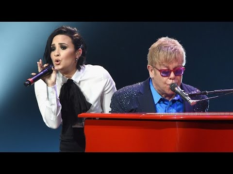 Elton John Pays Touching Tribute to David Bowie, Rocks Out With Demi Lovato